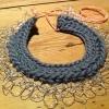Merino Wool, Silver thread, Argentinian ribbon.